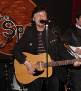 Mario of The PondHawks sings at The Spot