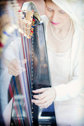 Harpist Anne Roos playing her Carbon Fiber Harp at a Summer Wedding