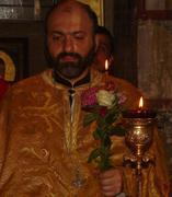 ბზობის სანთელი მამა იაკობის ხელში