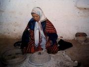 Tunisia: woman preparing bread