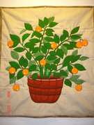An orange tree in a planter panel