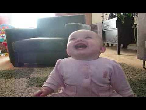 Baby Laughing At Popcorn Eating Dog