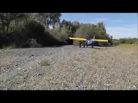 Zenith STOL - airplane take off and landing on river gravel bar