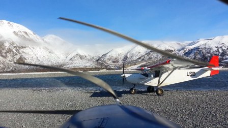 Take-off from island in Wamak River during the winter snow