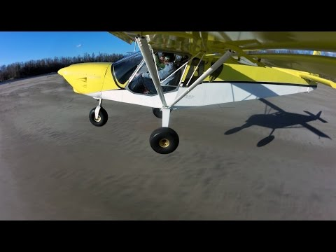 Landing on Missouri River sandbar - two airplanes - off airport