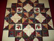 Log cabin up close,  hand quilted