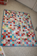 red corderoy and teal tied baby quilt