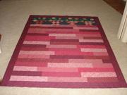 Strip quilt top with basket blocks.