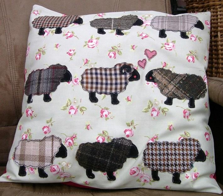 """I love ewe"" cushion on new pastures"