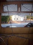 Rear view showing panels removed to treat rot