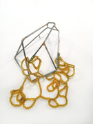 Stability and Fragility brooch with amber beads
