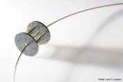 10-02.  Luis Méndez Artesanos - Silver & 18k gold pendant with steel wire