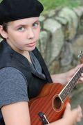 Zachariah playing ukulele