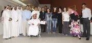 with students in Lakom Al Karar TV debate
