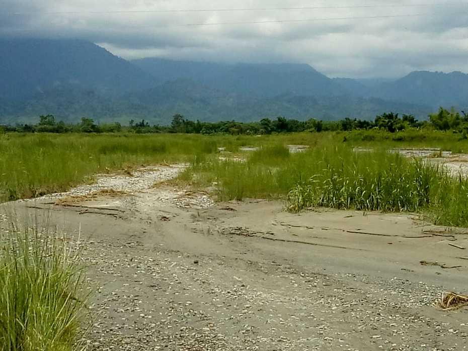 Dewsini River and mounts of the Arunachal Pradesh outside of the Jingabil village, Udalguri district