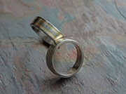 silver, gold, and steel hand fabricated jewellery