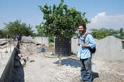 Chas Salmen showing off foundation of Ekialo Kiona Center, Mfangano Island, Kenya