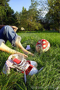 shoes-and-bare-feet-on-grass-thumb3359021