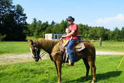 zach's first time on a horse riding daisy with chris2