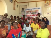 Young & older persons working together in Kabaale community
