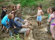 Kids decorating a dad in The Wallow