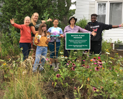 YEEP staff and students posing with the owner of a new meadow