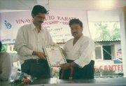 Receiving 8th Dan Certificate of International Budo Federation in 1997