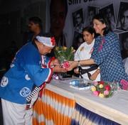 recievieing the award from     (Late) Film Star  Actor Sunil Dutt daughter Priya Dutt