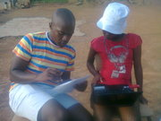 Rayzar helping a grade 10 learner do her research