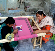 HDO-trained women doing hand embroidery