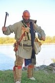 3809399-american-indian-wearing-war-paint-while-wielding-hatchet-and-knife