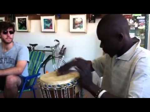 Badou shows how djembe done in Senegal