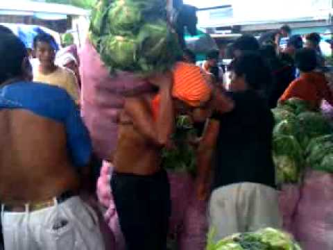 Skinny boys carrying 200lb sacks of veggies n Philippines