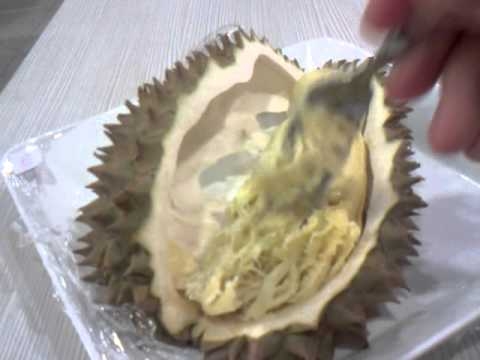 Eating durian inside foodcourt