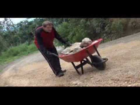 Pushing A Wheelbarrow Full Of Rocks Up A Mountain Challenge
