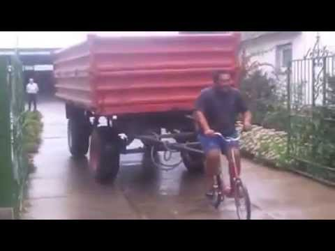 Cyclist Towing a Trailer Truck