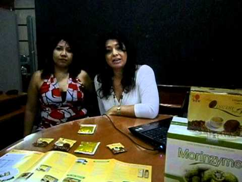 LORENA MUÑOZ Y NICOL  ASTUDILLO PROMOVIENDO EL CAFE LINGZHI EN TAMPICO