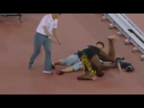 USAIN BOLT DAMAGED BY CHINESE CAMERA MAN ACCIDENT