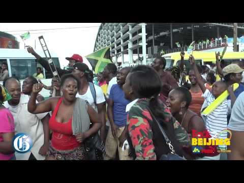 BEIJING BLURB: Jamaicans celebrate 4x100m in Half Way Tree