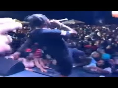 Popcaan Unruly Boss Uses Retarded Man to Sing His Song Stray Dog August 2017