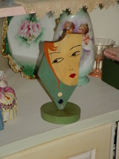 flapper face hat stand