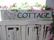 Bike on 75 yr Old Wood Sign 'Cottage'