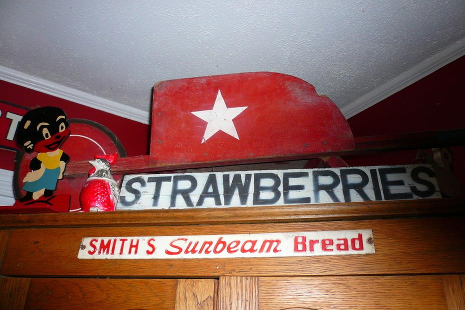 old signs & child's wheelbarrel
