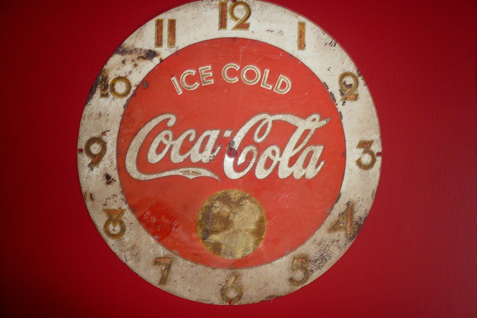 Old tin face from a coca cola clock