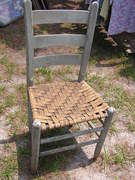 Old chair with leather strapping......$15.