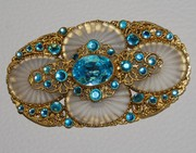 Deco and filigree brooches