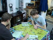 After offloading the Blood and Bridges truck Tyler and John sit down to play the game.