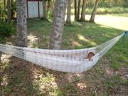 Izzat in his hammock made by his grandma - Rosa