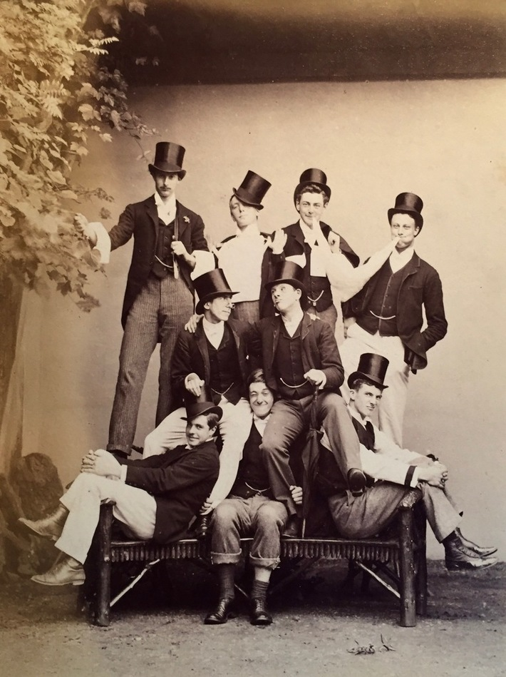 1870's university students in top hats. Eton?