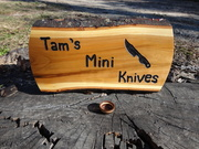 Wood sign with mini bowl in front of it